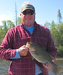 1st Trophy Smallmouth Bass by John Fishing with Family at Fireside Lodge